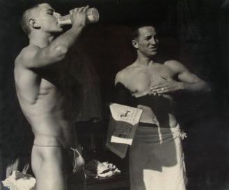 PH285 Two semi-nude men at the beach