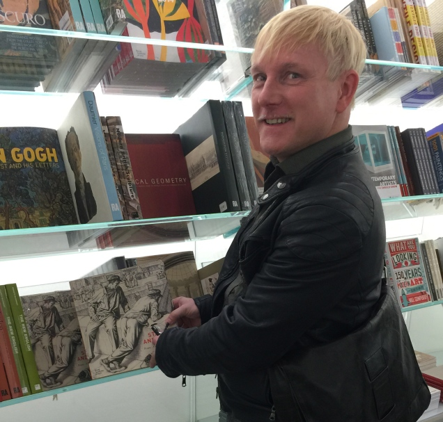 Heuser with catalogue in RA bookshop