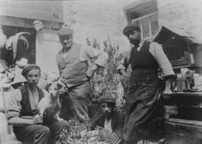 The Hutchings: James Senior, Fred (with dog), Walter sitting and George standing on the right © Ceredigion Museum
